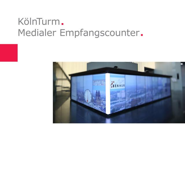Art-Invest Real Estate | Medialer Empfangscounter KölnTurm